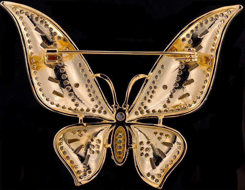 Brosche Schmetterling goldfarben mit blauen Details und vielen weissen Strass Steinen BR056 unten