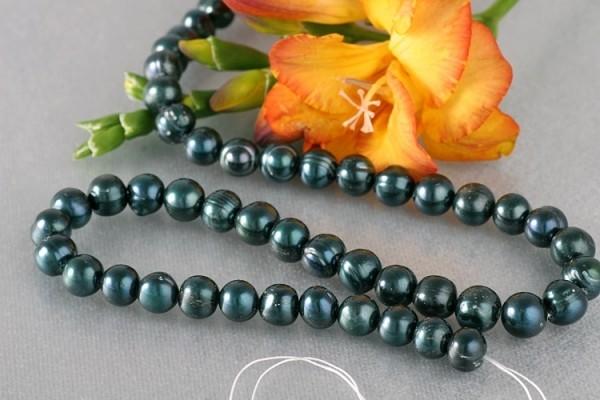 P397 Echter Zucht-Perlen-Strang offen ca. 38cm blauschwarz barock ca. 8mm