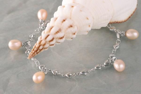 Silberarmband (Herzen) mit echten Süßwasserzuchtperlen Perlen oval ca. 6-7mm - lachs -